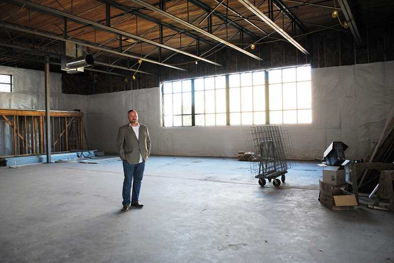 HILLSBORO TRIBUNE PHOTO: STEPHANIE HAUGEN - Scott Palmer, artistic director for Bag&Baggage Productions, stands in the empty concrete box that will be transformed into an intimate theater space over the next two years.