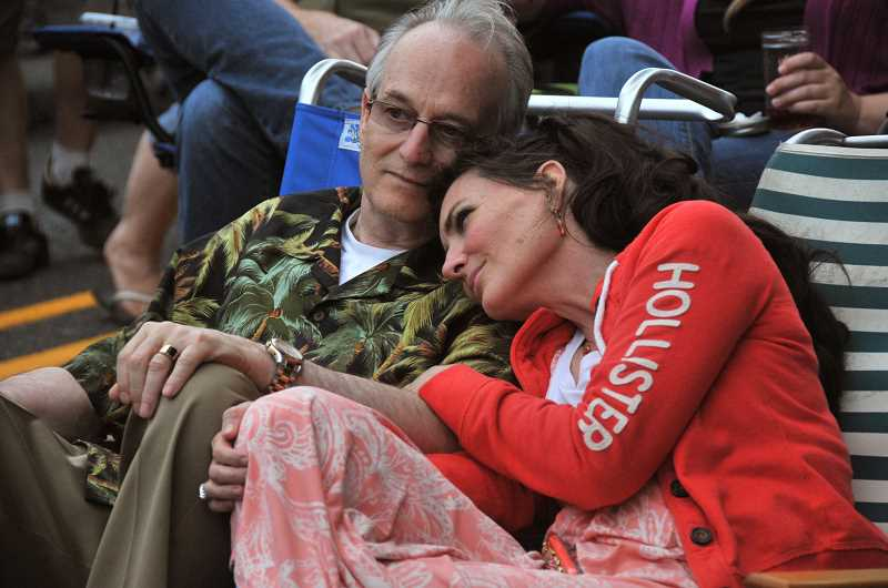 TIDINGS PHOTO: VERN UYETAKE - Bradley and Sabrina Shattuck relax while taking in the festivities at West Linns annual Street Dance July 11.