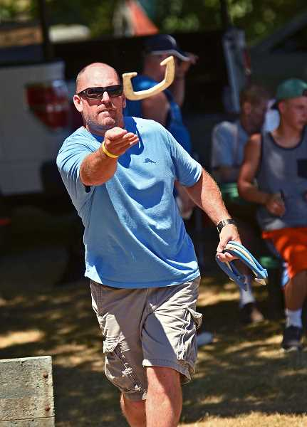TIDINGS PHOTO: VERN UYETAKE - Lee Gamble warms up for the horse shoe competition.