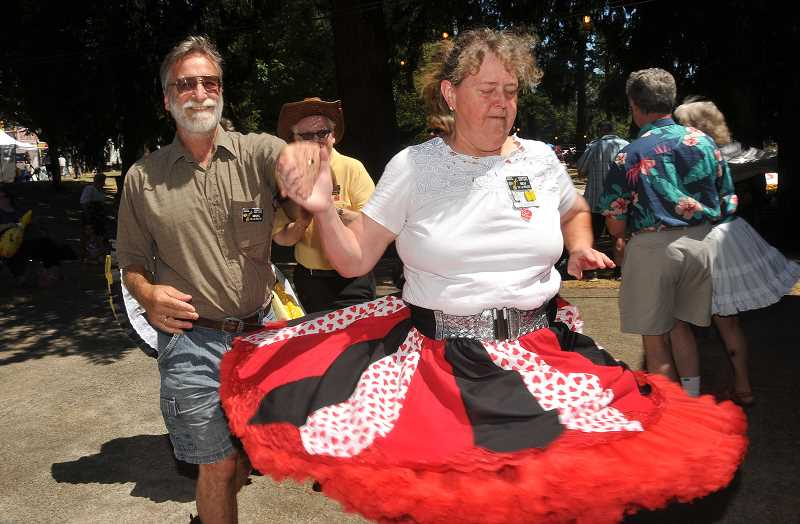 TIDINGS PHOTO: VERN UYETAKE - Marc and Bev De La Bruere show their square dance moves as members of the Country Cutups.