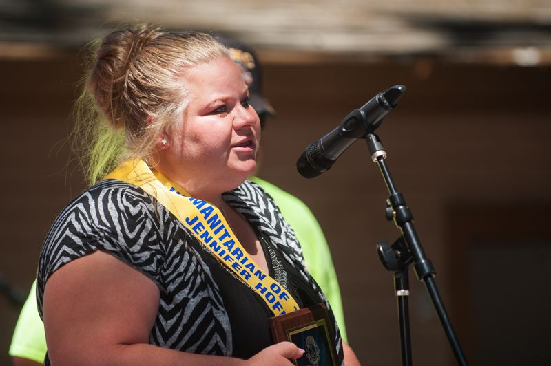 OUTLOOK PHOTO: JOSH KULLA - Jennifer Hoffman receives the 2015 Troutdale Lions Humanitarian of the Year award Saturday, July 18, at the Troutdale SummerFest celebration at Glenn Otto Park.