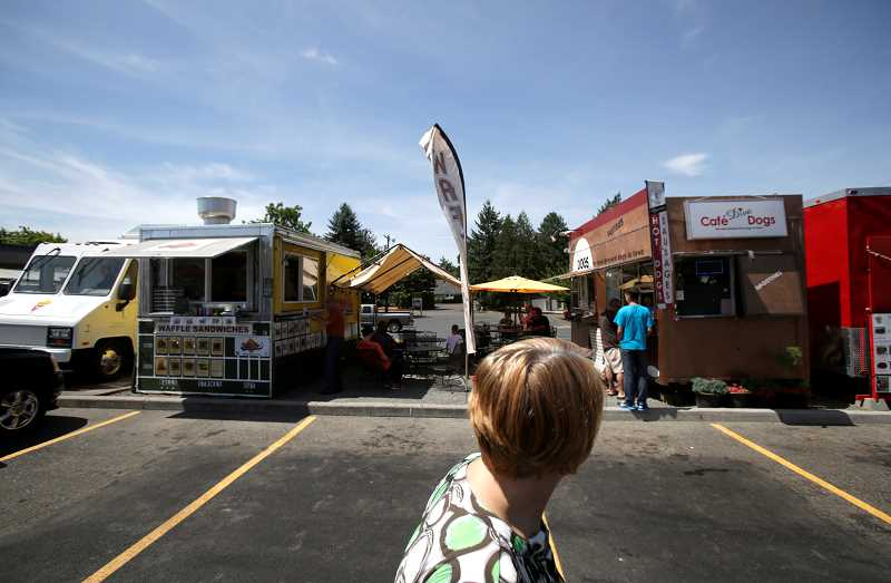 TIMES PHOTO: JONATHAN HOUSE - Beaverton residents currently have to travel a few miles to somewhere like The Eating Place at Aloha Mall for the food cart pod experience. That should change as the Beaverton City Council works to amend city codes to permit groups of mobile restaurants in the city.