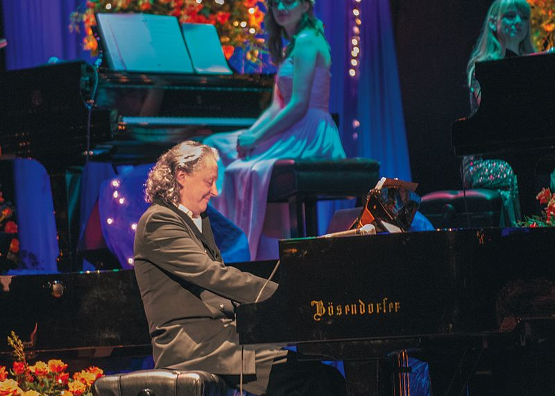 COURTESY PHOTOS: PETER VAN HOUTEN - Its quite a spectacle when pianists and 10 grand pianos fill the stage for the Ten Grands event (above), founded by Michael Allen Harrison. Ten Grands on the Green takes place on an Aloha golf course July 25.