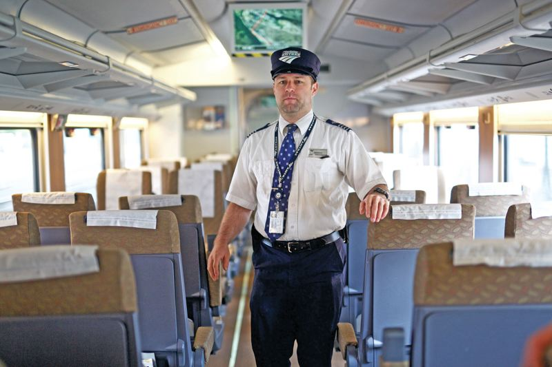 TRIBUNE PHOTO: JAIME VALDEZ - Amtrak Conductor Sheridan Hurd stands inside of an Amtrak Cascades train parked at Union Station.