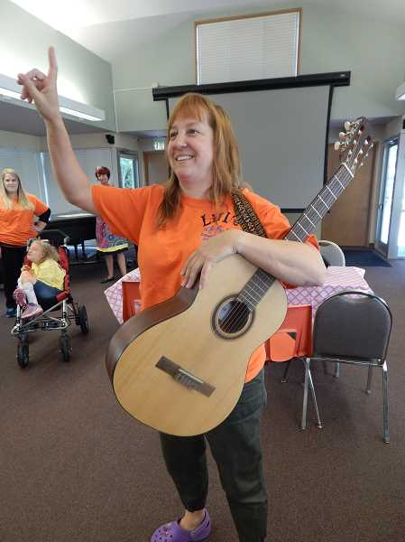 REVIEW PHOTO: CLIFF NEWELL - Lillieth Grand, founder and director of the Creative Arts Summer Camp at Marylhurst University, has a song for campers on the camp's last day on July 24.