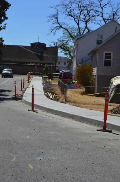 SPOTLIGHT PHOTO: MARK MILLER - A new concrete sidewalk is being constructed along the north side of Eisenschmidt Lane in St. Helens.