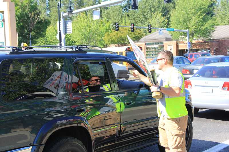 ALEXANDRA WALLACHY - Gresham Fire FIghter Mark Bancroft asks drivers to 'fill the boot' for muscular dystrophy.