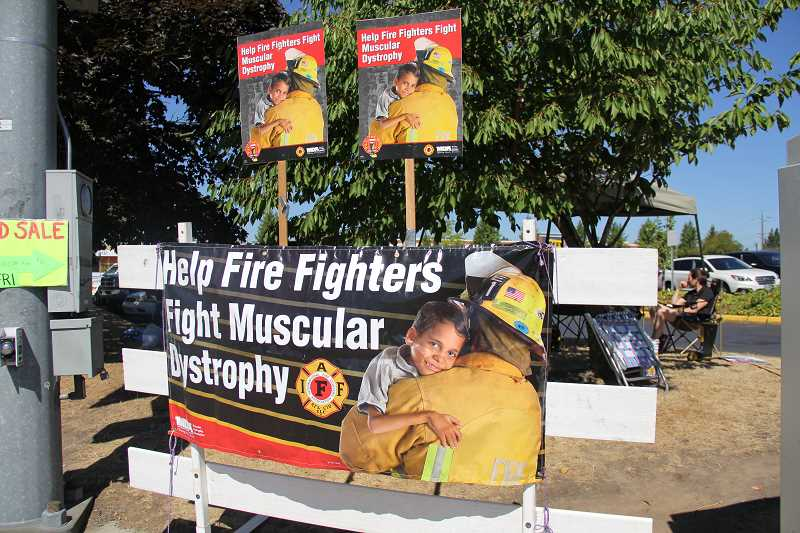 ALEXANDRA WALLACHY - Fire Fighter and volunteers held signs advocating for the MDA.