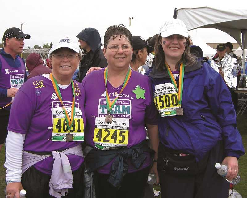 CONTRIBUTED PHOTO: SUE MERCER-CORY - Sue Mercer-Cory, Marsha DeJesus and Kathy Kelley after crossing the finish line of a half-marathon in Anchorage, Alaska.