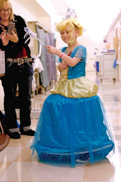 TIMES PHOTO: JONATHAN HOUSE - Navaeh Flynn plays in her princess costume donated by the Chelsea Hicks Foundation as she waits in between clinic appointments at Doernbecher Childrens Hospital in April. The organization aims to put a smile on the faces of children battling cancer through fun playtimes and dress ups.