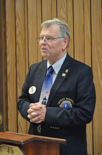 SPOTLIGHT FILE PHOTO - Hank Calhoun speaks at a St. Helens Lions Club meeting. The Lions Club is partnering with First United Methodist Church to send meals home with local students.