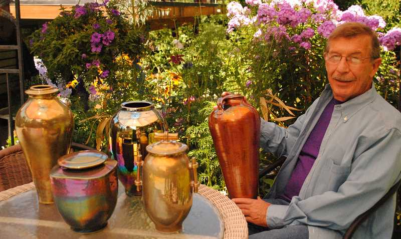 SUBMITTED PHOTOS:  - Artist Terry Hutchinson poses with a variety of his ceramic lusterware vessels.