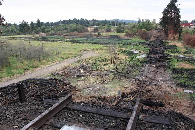 PAMPLIN MEDIA GROUP: DOUG BURKHARDT - Here's what the Sherwood trestle looked Aug. 28 when the fire had been put out and the remainder of the structure torn down.  Photographer Doug Burkhardt was facing west from the chemical company side of the trestle.