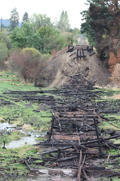 PAMPLIN MEDIA GROUP: DOUG BURKHARDT - The fire destoyed the trestle, along with eight acres of wetland. It's not clear whether the trestle will be rebuilt, Portland & Western said.