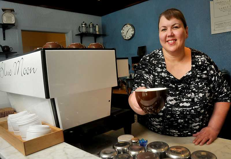 REVIEW PHOTO: VERN UYETAKE - Blue Moon Coffee owner Julia Fowler won the Chamber of Commerces Small Business of the Year Award in March. I was able to easily integrate into the community, she says, and there is definitely a sense of community here among the business owners.