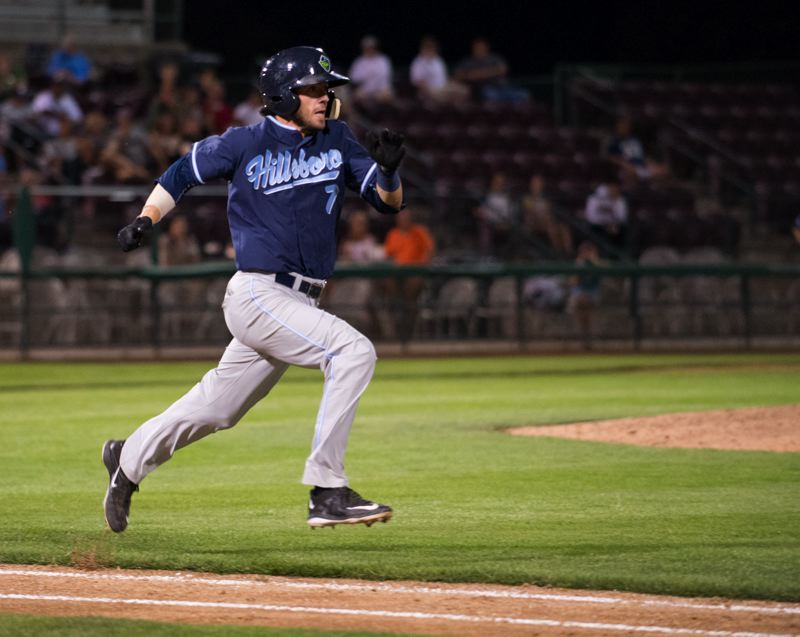 COURTESY: MOLLY J. SMITH/HILLSBORO HOPS - Dansby Swanson of the Hillsboro Hops speeds to first base during Saturday's Northwest League playoff game at Tri-City.
