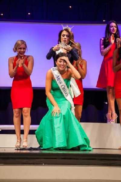 SUBMITTED PHOTO - This photo shows Ali Wallace getting crowned Miss Oregon at the start of summer. She immediately started preparing for the Miss America pageant held Sunday. The Sunset High School graduate finished out of the running on the national stage but will continue to represent Oregon.