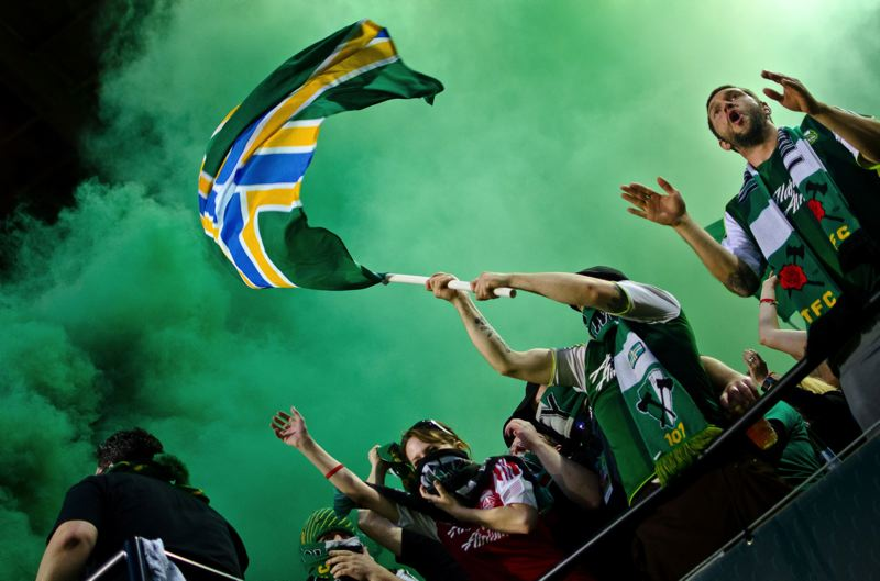 TRIBUNE FILE PHOTO - Members of the Portland Timbers Army will be honored in mid-October with a community award through the 2015 Governor's Volunteer Awards.