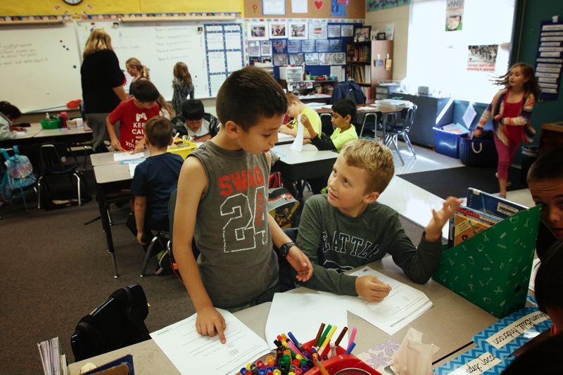 TIMES PHOTO: JONATHAN HOUSE - Andres Correa and Anderson Ball talk about a math problem in their Hazeldale third grade class.