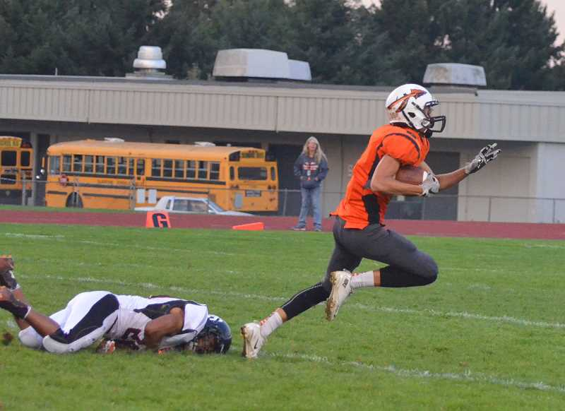SPOTLIGHT PHOTO: JOHN BREWINGTON - The Scappoose Indians started their offense against Gladstone with a 65-yard touchdown pass from Robert Lohman to Brennen McNabb.