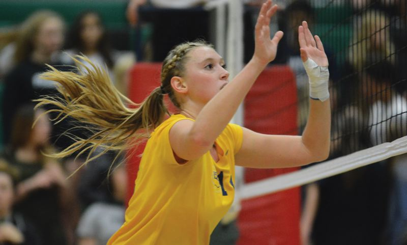 THE OUTLOOK: DAVID BALL - Barlows Brynna Stauffer gathers herself in the middle before going up for a block during Thursdays five-set road win at Reynolds.