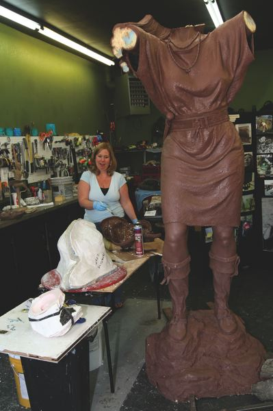 CONTRIBUTED PHOTO  - Heather Soderberg, a prominent Cascade Locks bronze sculptor, works on a piece. The Soderberg Studio is among those participating in the first ever Troutdale Fall Festival of the Arts Oct. 2-4.