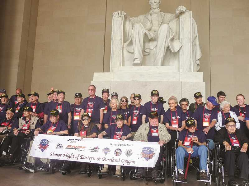 OUTLOOK PHOTO: SHANNON O. WELLS - Honor Flight Network of Eastern and Portland assemble at the base of President Abraham Lincolns statue in the Lincoln Memorial in Washington, D.C. The veterans joined their voices to sing God Bless America on Saturday morning, Sept. 19.
