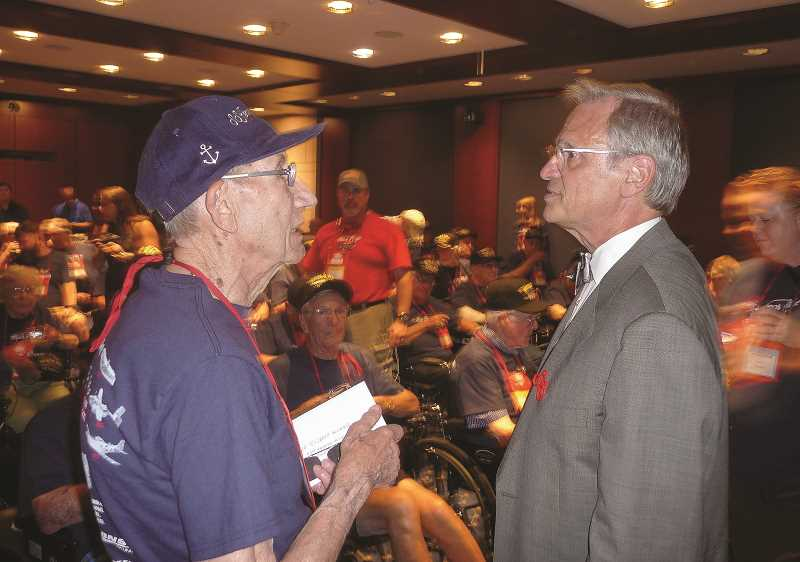 OUTLOOK PHOTO: SHANNON O. WELLS - World War II veteran Harold Englet chats with U.S. Rep. Earl Blumenauer (D-District 4) in the Visitors Center of the U.S. Capitol in Washington, D.C., on Friday, Sept. 18. Blumenauer greeted Englet, who was among 50 veterans on an Honor Flight of Oregon-sponsored tour of the nations capital city.   6) Red Fortner, a Gresham resident and World War II veteran, takes a load off at the National World War II Memorial in Washington, D.C. Behind him is his son, R.D., who served as Reds guardian companion on the Honor Flight of Oregon tour.   7) During a plane flight from Washington, D.C., Lyle Wescott, a Northeast Portland resident, reads a letter from an elementary school student thanking him for his service in World War II. Honor Flight veterans were treated to mail call on the last leg of their flight.