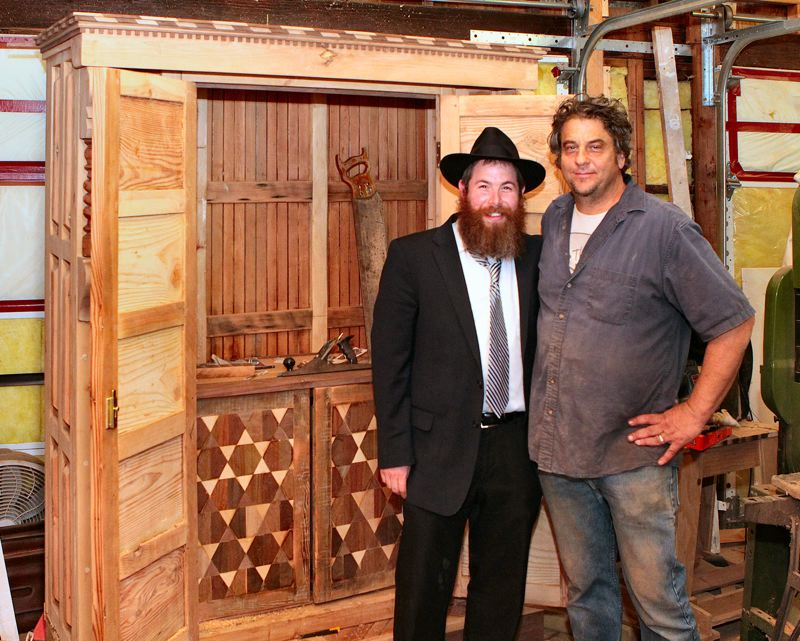 DAVID F. ASHTON - Rabbi Dov Bialo of the Southeast Portland Chabad House, left, is clearly pleased with the unique Aron Kodesh fashioned by Westmoreland resident Lenny Hoffman, at right, which will soon hold the schuls Torah scroll.
