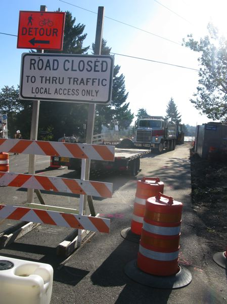 PHOTO BY: RAYMOND RENDLEMAN - Strawberry Lane, a major east-west thoroughfare for unincorporated Clackamas County, was closed at its crossing of Interstate 205.