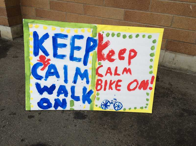 PHOTO COURTESY OF BEAVERTON SAFE ROUTES TO SCHOOL - Oak Hills Elementary School students got a bit of encouragement as hundreds of them walked or biked to school Wednesday.