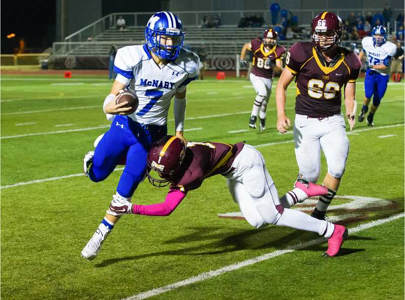 NEWS-TIMES PHOTO: KENT FRASURE - Chino Davis of Forest Grove tackles McNary quarterback Trent Van Cleave during the Vikings' 51-28 loss to the Celts on Thursday night.