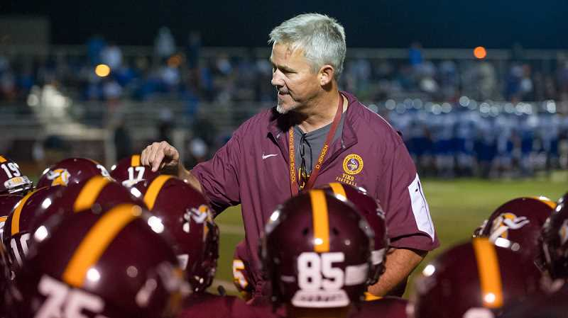 NEWS-TIMES PHOTO: KENT FRASURE - Forest Grove head coach Dwight Jensen gives his Vikings a pep talk right before the start of the second half during Thursday's 51-28 loss to McNary.