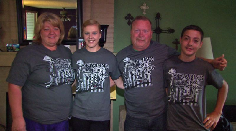 PHOTO: KOIN 6 NEWS - The Holmes family all wear their patriotic shirts.