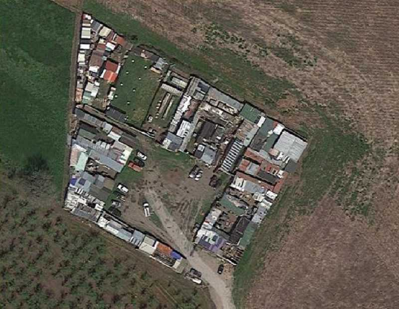 SUBMITTED PHOTO - This compound of buildings just southwest of Aloha is where investigators serving search warrants related to a large methemphetamine ring also found more than 1,600 chickens, many of which are believed to be used in illegal cockfighting.