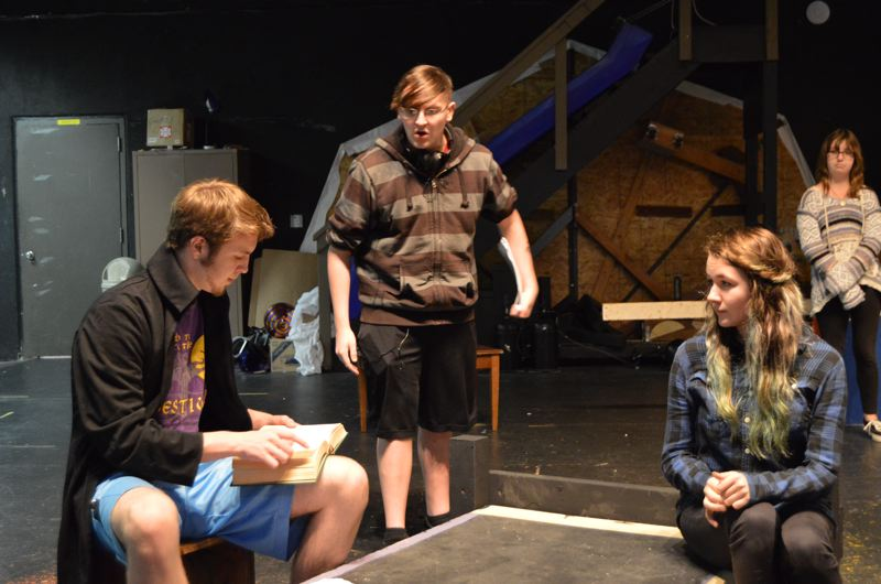 SPOTLIGHT PHOTO: NICOLE THILL - Josh Farrell, a homeschooled senior, Hunter Hall, a junior, and Rycca Loosi, a freshman, run through lines on stage on Tuesday, Oct. 20. Students will start doing dress rehearsals next week.