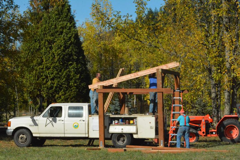 SPOTLIGHT PHOTO: COURTNEY VAUGHN - A Columbia County maintenance crew erects a small shade station to be installed at Asburry Acres just outside city limits in St. Helens. The park area is getting pet-friendly features.