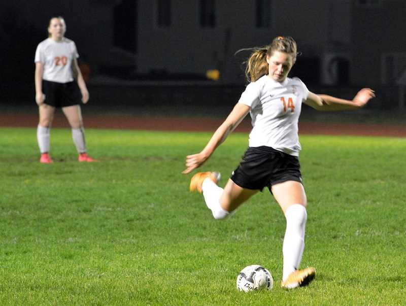 SPOTLIGHT PHOTO: JAKE MCNEAL - Eleanor Jones (14) and the Class 4A No. 2-ranked Scappoose High School girls' soccer team beat 10th-ranked defending state champion Valley Catholic 5-0 for the Cowapa League title on Tuesday in Scappoose.