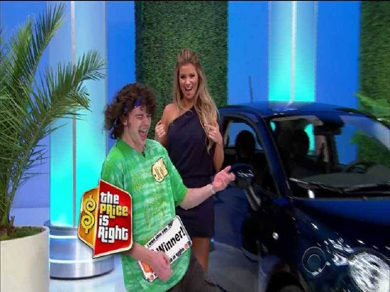 CONTRIBUTED PHOTO: KOIN 6 - Jed Dyal performs an air-guitar solo after winning a Fiat on The Price is Right.