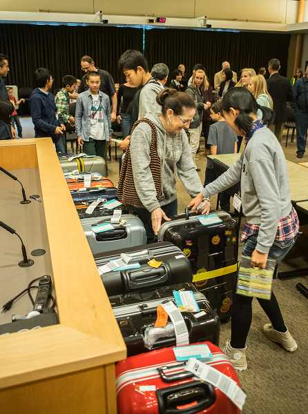 Students from Nuyzen, Japan, grab their luggage and head off for an evening with their Forest Grove host families.