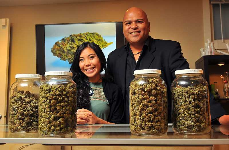 REVIEW PHOTO: VERN UYETAKE - Divine Kind owner Al Ochosa (right) and employee Vina Wilson await customers in the Terwilliger Boulevard marijuana dispensary, which began selling recreational pot in October and joined the Lake Oswego Chamber of Commerce.