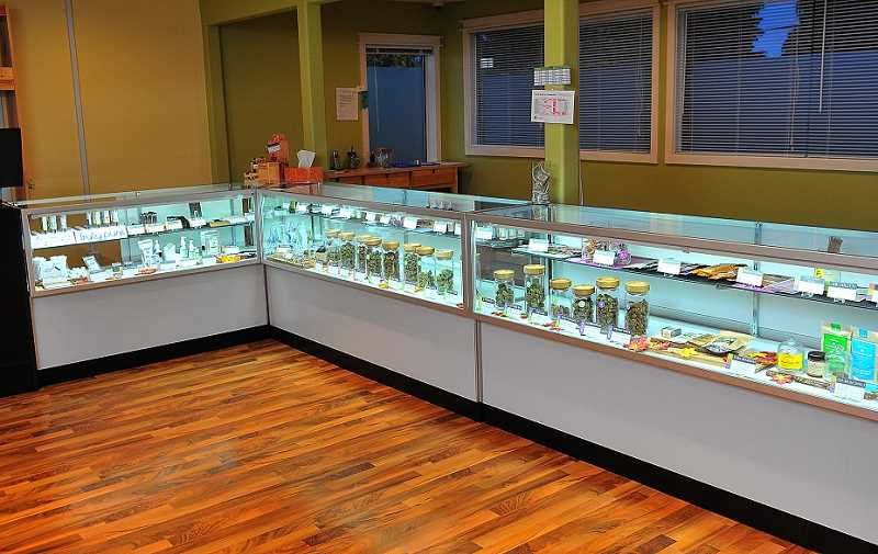 REVIEW PHOTO: VERN UYETAKE - At Divine Kind, the line between the medical and recreational operations is well drawn. Each has its own separate entrance, with the medical sales staff on the upper level and the recreational retail operation downstairs.