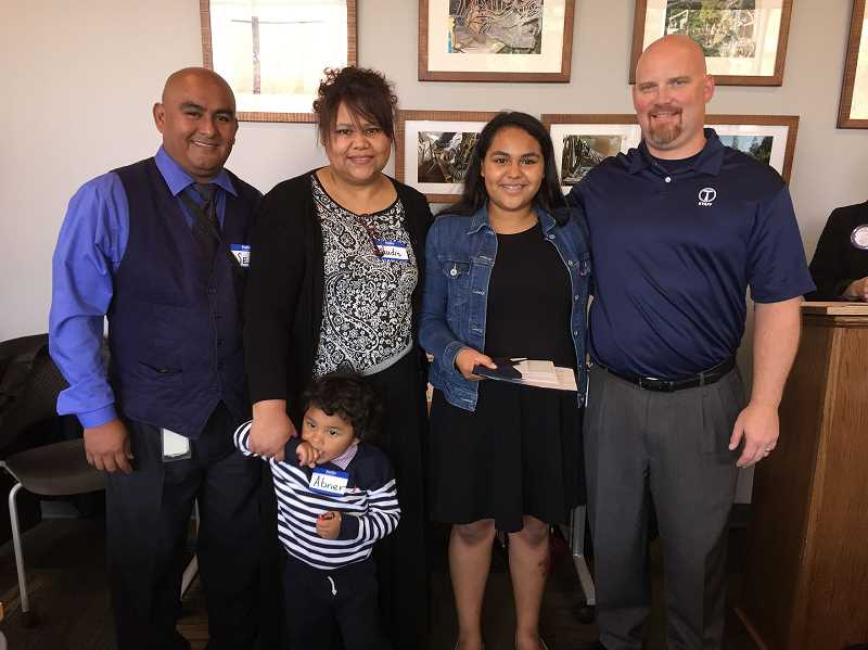 COURTESY PHOTOS: ROTARY CLUB OF FOREST GROVE - Elamny Hernandez-Guarema poses with her family to be recognized at Rotary.