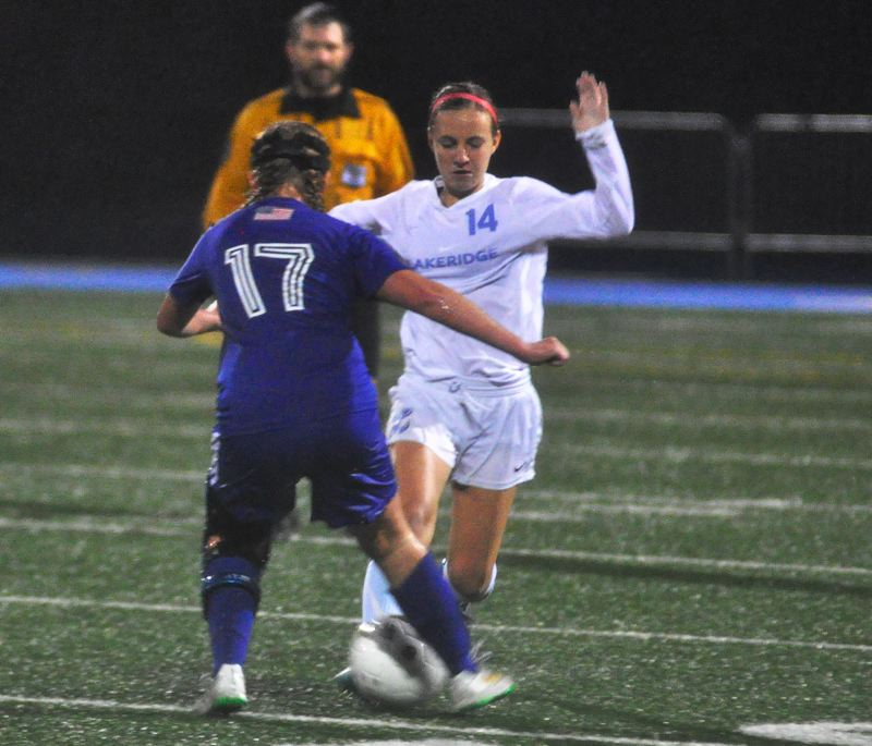 MATTHEW SHERMAN - Lakeridge's Ashlynn Lawston tries to get past a Grants Pass defender in Saturday's game. She scored the Pacers' third goal in a 3-0 win.
