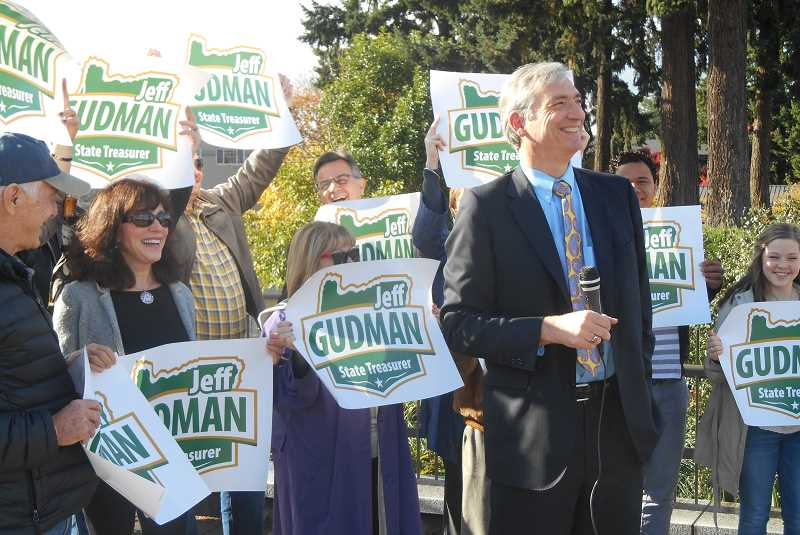 REVIEW PHOTO - Surrounded by supporters in Millennium Plaza Park, Lake Oswego City Councilor Jeff Gudman announces Monday that he will seek the Republican nomination for state treasurer in 2016.