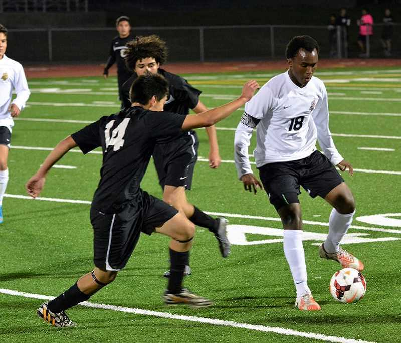 SPOTLIGHT PHOTO: JAKE MCNEAL - St. Helens' Victor Omboke is a Northwest Oregon Conference honorable mention midfielder.