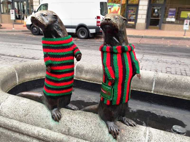 COURTESY: PORTLAND BUSINESS ALLIANCE  - Downtown's otter statues looked positively dapper last year in these vintage yarn-bombed sweaters. The statues get new duds this season to keep holiday shoppers smiling.