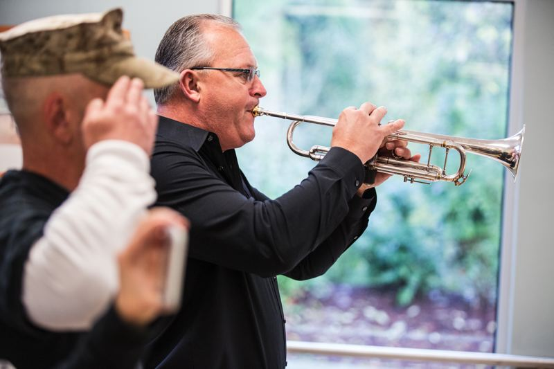 TIMES PHOTO: JONATHAN HOUSE - Martin Murrell plays 'The Star Spangled Banner' at Tualatin's veterans recognition breakfast on Monday.