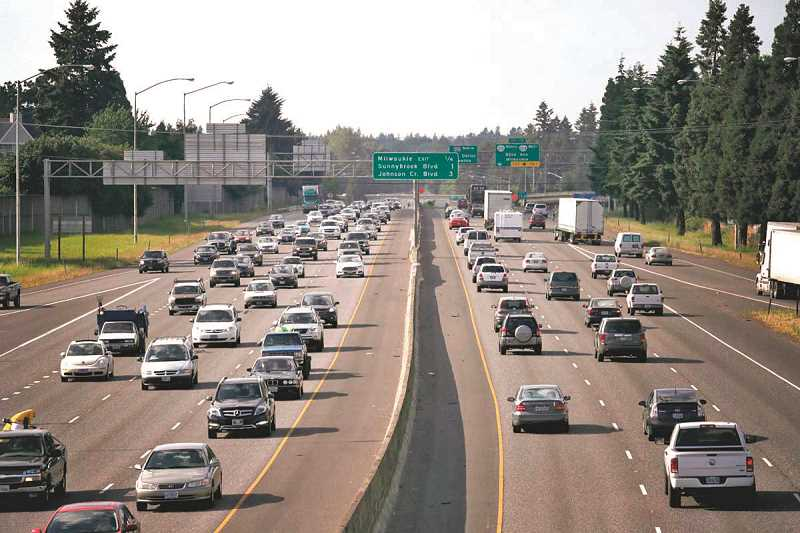 REVIEW FILE PHOTO - Evening rush hour starts to jam in both directions on I-205 in Clackamas County. Since 2001, the state has been searching for options to charge people for using Oregons roads and highways.