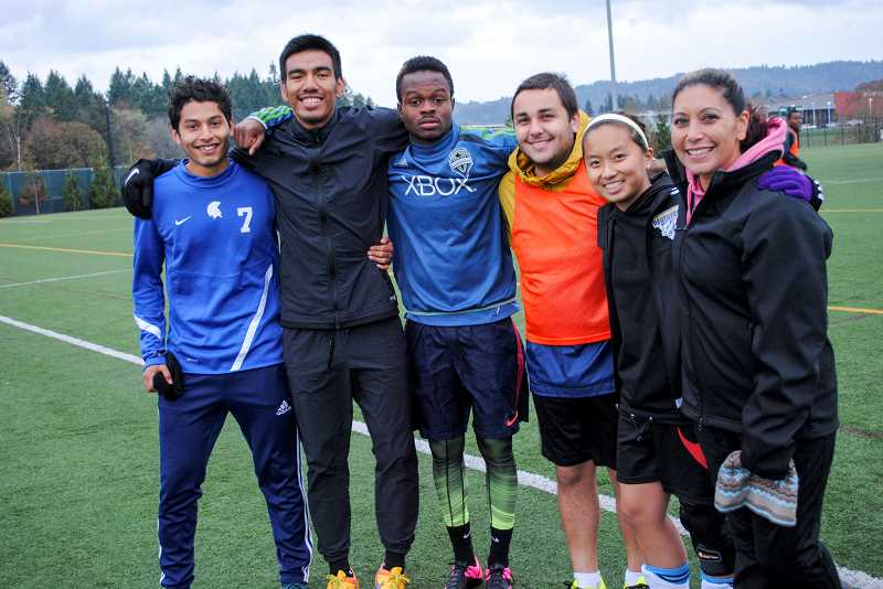 NEWS-TIMES PHOTO: STEPHANIE HAUGEN - (Left to right) Jose Mendez-Zepeda, Jose De La Torre, Ibrahim Turay, Dmitrik Vidalez-Sandoval, Nichola Wong and Delia McQueen braved the wind, rain and cold last week on PCCs Rock Creek Campus to play soccer.